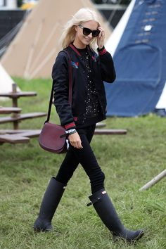 Poppy Delevingne paired her Markus Lupfer jumper with a Coach varsity jacket, bag and sunglasses (Glastonbury Festival 2016)