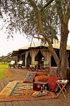 "Singita Sabora Tented Camp - Grumeti Reserves, Tanzania. Yes, I know this doesn't belong on a ""garden"" board, but I had to pin it somewhere. It's the poster child for glamping, for sure."