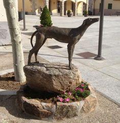 Hound statue in a Spanish village