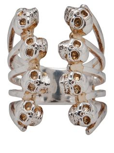 Babel skull ring in silver from Delfina Delettrez featuring two rows of four skulls with yellow gold trim