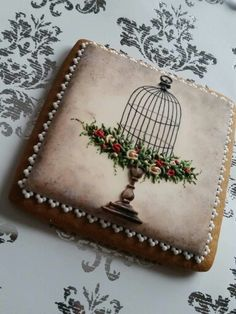 Mezesmanna: Birdcage with a bed of roses. Beautiful!