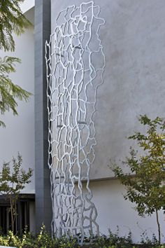 Stunning sculpture set against a glass faced rendered wall - home designed and built by Urbane Projects, Perth. Landscaping by Tim Davies Landscaping. Photo by Grab Photography Perth, Luxury Homes, Landscaping, House Design, Sculpture, Building, Glass, Wall, Projects