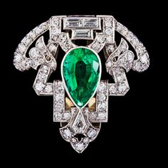An Art Deco Columbian emerald and diamond clip, app 4 cts, resp, tot. app. 1.50 cts. 1930's.
