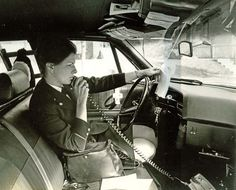 Elizabeth Robinson sitting in squad car, ca. 1970. 2011.40.78. Collection of the National Law Enforcement Museum, Washington, DC.