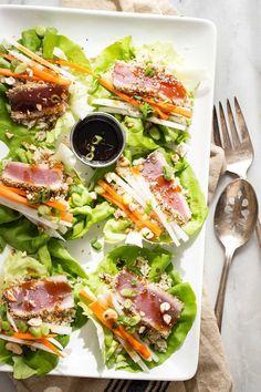 Sashimi grade seared ahi tuna with brown rice, daikon radish, carrots and topped…
