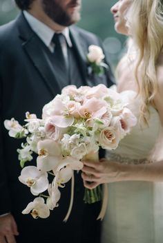 Pink cabbage rose, white peony and pink orchid cascading bouquet by Tiger Lily Weddings