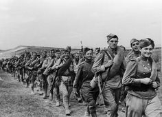"""""""Soldiers on the march"""". Red Army soldiers on the march, the second world war. In all out war many women were serving at the front, completely integrated into combat units alongside men."""