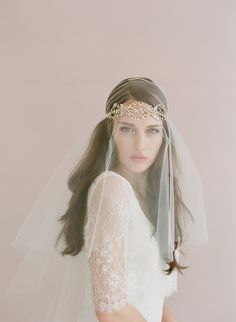 A gorgeous infinite loops headband of sparkling crystals. Hand wired swarovski crystals Crystal encrusted charms Hand finished with ivory satin ribbons Veil sty