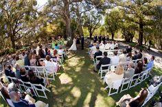 Beautiful ceremonies amidst tall trees...