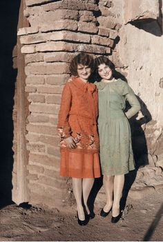 1920s Colorized photo of two teens in simple dresses