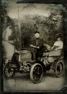Motorized. ca. 1910. I wonder if the car was a regular prop or brought into the studio especially for this photo