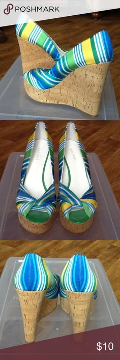 """Nine West Striped Cork Wedge Platforms Size 10M Nine West """"Chill Pills"""" style cork wedge platform pump with peep toe. Cute fabric upper is striped in yellow, green, white and shades of blue. 1 1/2 inch platform with 5 1/4 inch cork heel. Very good used condition. Perfect for Spring and Summer! Size 10 M. Bundle and save 20% Nine West Shoes Wedges"""