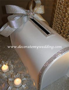 Collect your cards and well wishes in this stunning linen rhinestone card box. Your guests will be in awe as they drop their card in the box! White with silver rhinestone trim and ribbons. Check out complete collection - card box, guest book, flower girl basket, ring pillow, crystal corsage, candle accent.