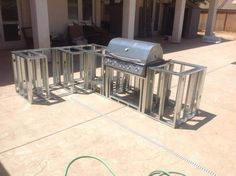 How to Build a BBQ Island with Steel Studs Looking to build the ultimate outdoor kitchen and patio? Here's how to use steel studs and tracks to built the perfect outdoor BBQ island for your backyard. Outdoor Grill Area, Outdoor Grill Station, Outdoor Kitchen Plans, Backyard Kitchen, Outdoor Kitchen Design, Backyard Patio, Outdoor Bars, Kitchen Grill, Kitchen Bars