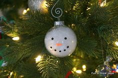 How to make an snowman ornament with kids - clear glass ball, art. snow, and fabric paint