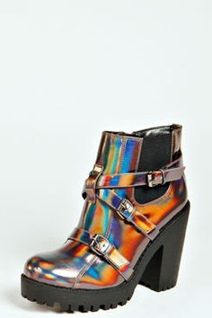 Calling all futuristic fashionistas - the Maddy Holographic Buckle Chunky Boot is waiting for you.