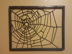 #spiderwebart This is one I made that is hanging above my tarantulas cage. Its extremely light, I just have it taped to the wall. I can make one however big or small you want. I can also do silver to make is seem more realistic. It would also look very neat with a candle behind it at night! For all you spider lovers out there *wink. Or just anyone who appreciates natures art