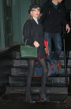 f401a99539c2 Taylor Swift Flaunts a Violet Bomber and Dress in NYC