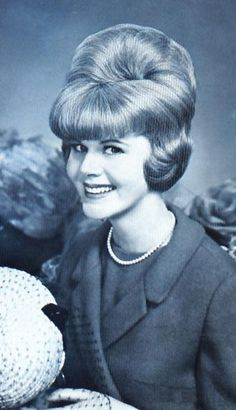 bouffant from 1964.. just be glad your hair does not look like this anymore...although some tv anchor women come close..