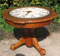 Coffee table with clockface and Latin script in gold leaf.