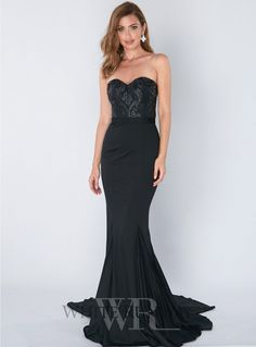 Elsa Gown. A beautiful full length dress by Jadore. A sweetheart strapless style featuring lace applique on the bodice and a floor sweeping train.