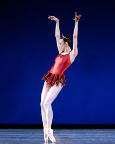 """Principal dancer Lindsi Dec in Rubies, part of George Balanchine's """"Jewels."""" Pacific Northwest Ballet, Sept./Oct., 2014. Photograph by Angela Sterling."""