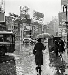 "maudelynn:   March 1943. Times Square on a rainy day.""  Photo by John Vachon  via shorpy.com"
