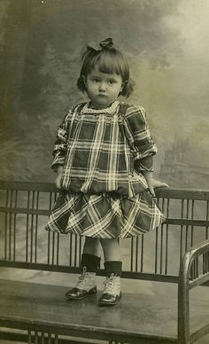 :::::::::: Vintage Photograph ::::::::::  solemn little girl in plaid