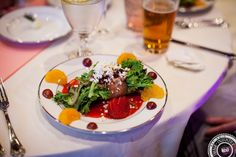 Plated salad with feta cheese, grapes and mandarin oranges topped off with a delicious vinaigrette!