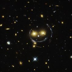 Hubble Telescope Discovers Smiley Faced-Shaped Galaxy Cluster OMG! There's An Emoticon-Shaped Galaxy Cluster Smiling Down From Space!