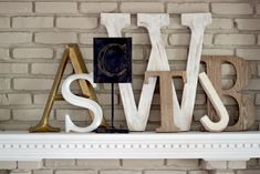"""Family initials on the mantle from Design Mom's  house tour """"Living With Kids: Tracey Willey"""""""