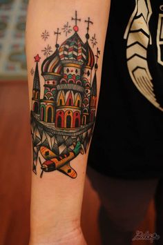 Karolina Bebop gives the Kremlin and an antique aeroplane a stylized look in this decorative tattoo