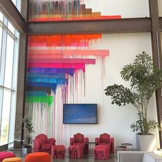 Talk about an accent wall! Just one of the cool spaces in Facebook's new office