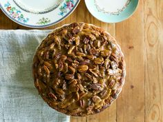 """Apple pie and pecan pie: two world-famous classics. But let's be honest, one's a little wholesome and the other's a little too sweet. You know which is which. But what if we combine them into a single pie with an apple filling and pecan bourbon-caramel top """"crust""""? And what if we told you it's easier to make and assemble than either of the originals? This may be the greatest pie mashup ever."""