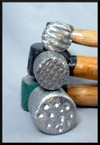 Blogger says: You can make texturing hammers out of cheap ball peen hammers. I filed the faces of the hammers and used grinding tools on my flex shaft (you can also use a rotary tool) to get some interesting textures. .. ornamento.wordpress.com/2011/02/10/more-ideas-for-making-jewelry-tools/