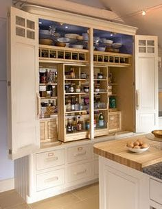 Kitchen Storage- love this cabinet!! Could fit everything in it.