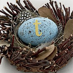Take inspiration from a speckled robin's egg for this place marker: Paint your hard-boiled egg a light blue, dip a brush into some watered-down brown paint, and use your thumb to splatter the paint off the brush and onto the egg. Once the egg is dry, add a colorful letter sticker with your guest's initial. Place the egg just as it is on your guest's napkin or rest it in a craft-store nest.