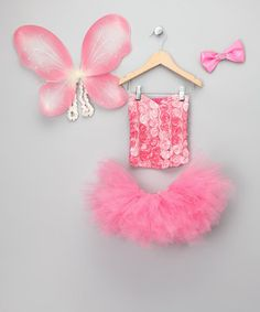 """Kissed with sparkles and blossoming with fairy flowers, this enchanting set casts a magical glow. Boasting a cloud of tulle, satin-strapped wings, a matching bow and a rosette-covered top, these pretty USA-made pieces are ready to whirl and twirl to the """"Dance of the Sugarplum Fairy."""""""
