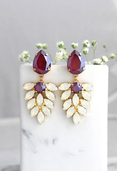 Maroon Earrings, Bridal Burgundy Earrings, Dark Red Chandelier Earrings, Red Swarovski Drop Earrings, Bridal Garnet Chandelier Earrings IF YOU WANT THE BEST CHOSE THE ORIGINAL Arrives in our signature Petite Delights by Ilona Rubin® Box. Sent By Registered Insured international mail. Petite delights® design . Petite Delights® is an Official SWAROVSKI® Branding Partner Official Swarovski Elements® Partner Made with real genuine high quality Austrian Swarovski ©Crystal . Our brand is legally li... Garnet Earrings, Red Earrings, Fashion Earrings, Diamond Earrings, Bridesmaid Earrings, Bridal Earrings, Bridal Jewelry, Silver Jewelry, Amethyst Jewelry