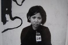 """One of 1.5 million citizens tagged, documented, and executed by the Khmer Rouge for the crime of """"being educated,"""" Cambodia, 1978"""
