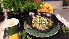 John Whaite's in the kitchen putting a twist on a classic dish with his pea risotto and minty feta.