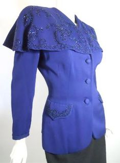 1940s deep blue lightweight wool  jacket with shawl collar loaded with  carnival glass beading.