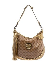 Gucci Hysteria Waxed GG Canvas Studded Tassel Hobo--$345 #GucciHandbags Buy this bag on our website, now! http://www.cashinmybag.com/product/gucci-hysteria-waxed-gg-canvas-studded-tassel-hobo/ This Gucci Babouska hobo shows scuffing and staining to the exterior. The hardware is scratched and tarnished. The interior has discoloration and the long shoulder strap is missing. It features a zipper closure and two interior pockets.