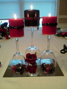 upside down wine glasses- mix with wine bottle center pieces- love it