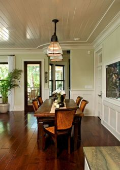 this dining. Plantation, palm.. White shiny ceiling, dark table and floors, cane chairs and green. Love!