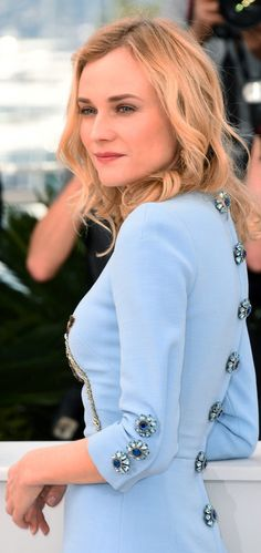 The actress made her Cannes debut at the photo call for Disorder in a powder blue Dolce & Gabbana dress embellished with a sequin rose and crystal buttons, which adorned the sleeves and back of the design. She let the Fall 2015 mini shine by completing her look with neutral ankle-strap sandals.