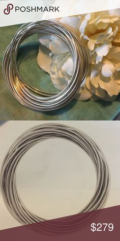 21-Bangle Salute A customer favorite! 21 BANGLES interlocked. .925 Sterling silver, nickel free and handcrafted! These are hard to find.... a must have!! Silpada Jewelry Bracelets