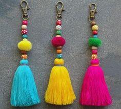Items similar to Tassel Pom Pom Keychain Bag Charm - Zipper Pull - BOHO Chic - Wooden Beads - Pink Aqua Yellow tassels - Green Red Pompom on Etsy Pom Pom Crafts, Yarn Crafts, Sewing Crafts, Diy Keychain, Tassel Keychain, Diy Tassel, Tassels, Pom Pom Bag Charm, Boho Chic