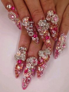 gem stone encrusted gyaru nails: probably inhibit normal function and are germ traps but interesting to see