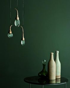 """round 3 buds  description  solid cast bronze buds (polished), each housing tempered glass drop illuminated by LED   also available in satin nickel finish    bulb holders  3x LED lights    dimensions  canopy size - 12cm diam (6"""" diam)  bud cluster height - 40cm h (14"""" h)  overall height to be determined"""